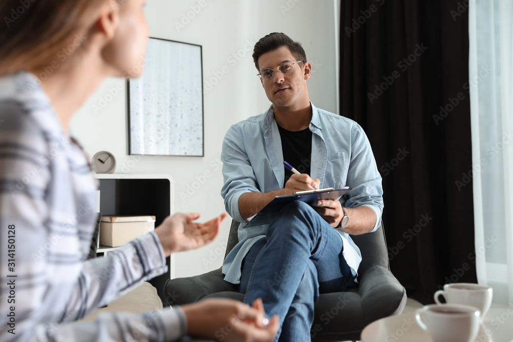 Fototapeta Professional psychotherapist working with patient in office