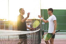 Father And Son Playing Tennis ...
