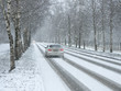 Winter traffic cars. Winter country road in snowfall