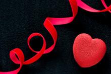 Valentines Day Concept. Red Velvet Heart Shaped Cake On Black Background With Red Velvet Ribbon