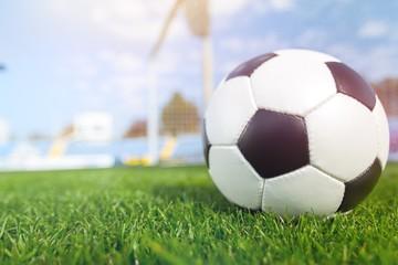 Classic soccer ball player on the stadium grass