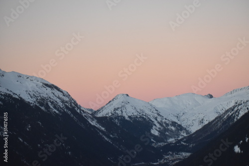 snowy mountain tops in sunset