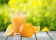 Orange juice and slices of orange fruit in glass
