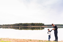 Father Skipping Stones At The ...