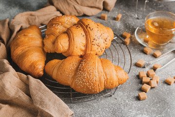 Tasty fresh croissants on table