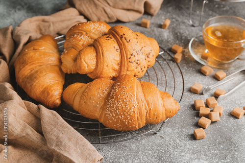Obraz Tasty fresh croissants on table - fototapety do salonu