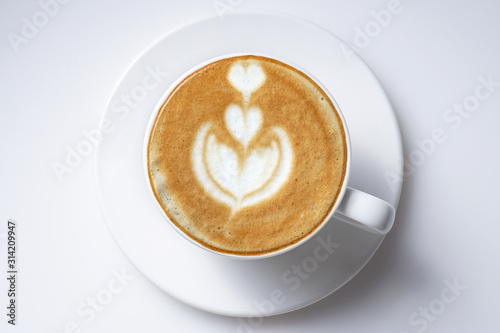 Fotografie, Obraz Cup of coffee latte art from top close up  isolated on white with space