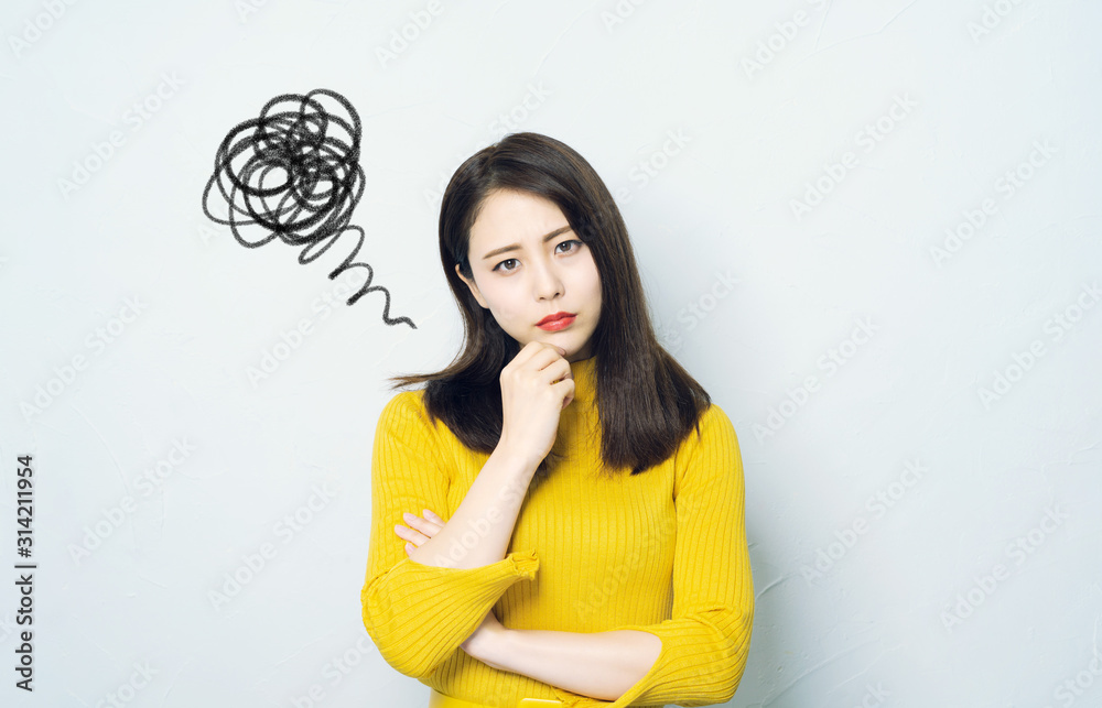 Fototapeta 不満顔の女性