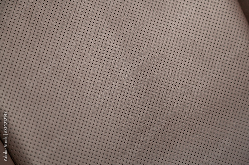 Fototapeta close-up white perforated leather car seat. Skin texture