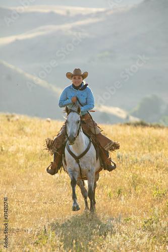 Fototapeta horseback riding in mountains