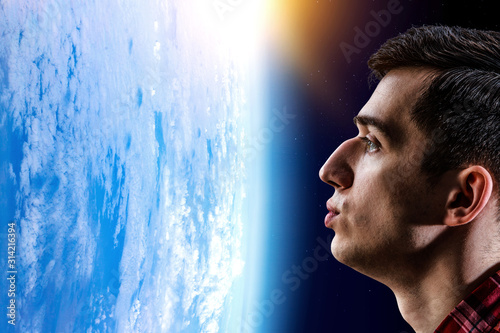 Girl kissing Earth planet . Mixed media