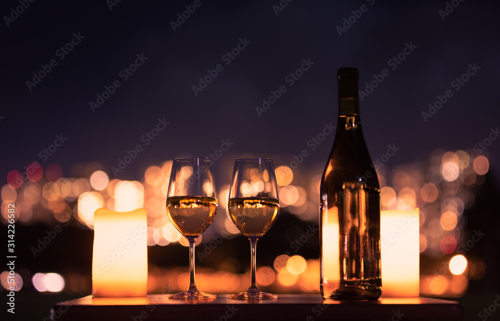 Fototapeta Candlelight dinner with wine and romantic city view.