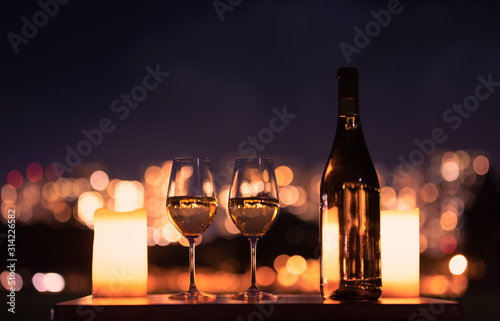 Candlelight dinner with wine and romantic city view. - 314226582