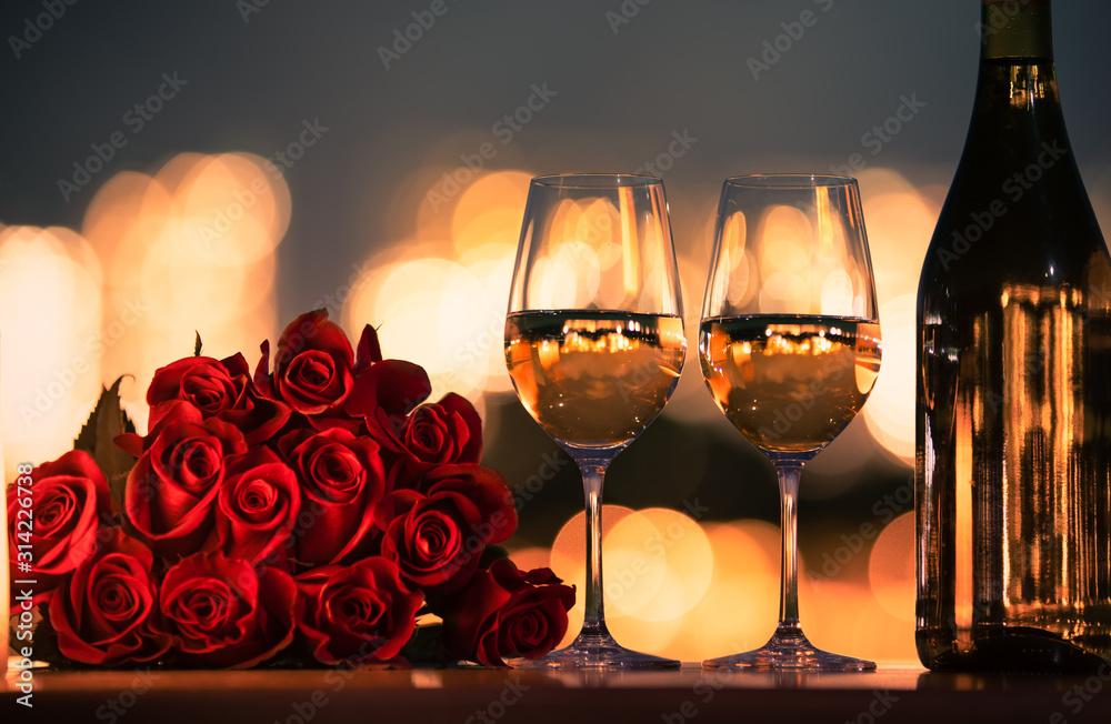 Fototapeta Romantic dinner date night with roses and wine.