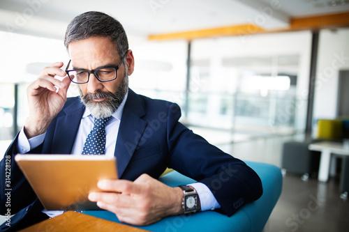 Cuadros en Lienzo Shot of thinking financial advisor businessman working in office.