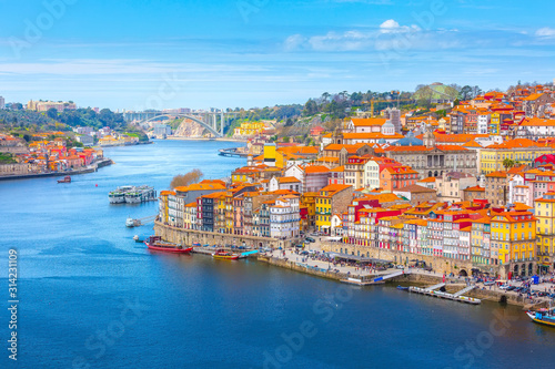 Porto, Portugal old town ribeira aerial promenade view with colorful houses, Dou Canvas Print