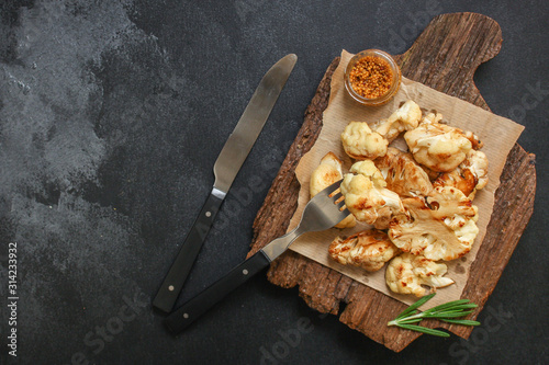 Fototapeta cauliflower grilled (fried grill vegetables or snack salad cabage) menu concept. food background. copy space. Top view obraz