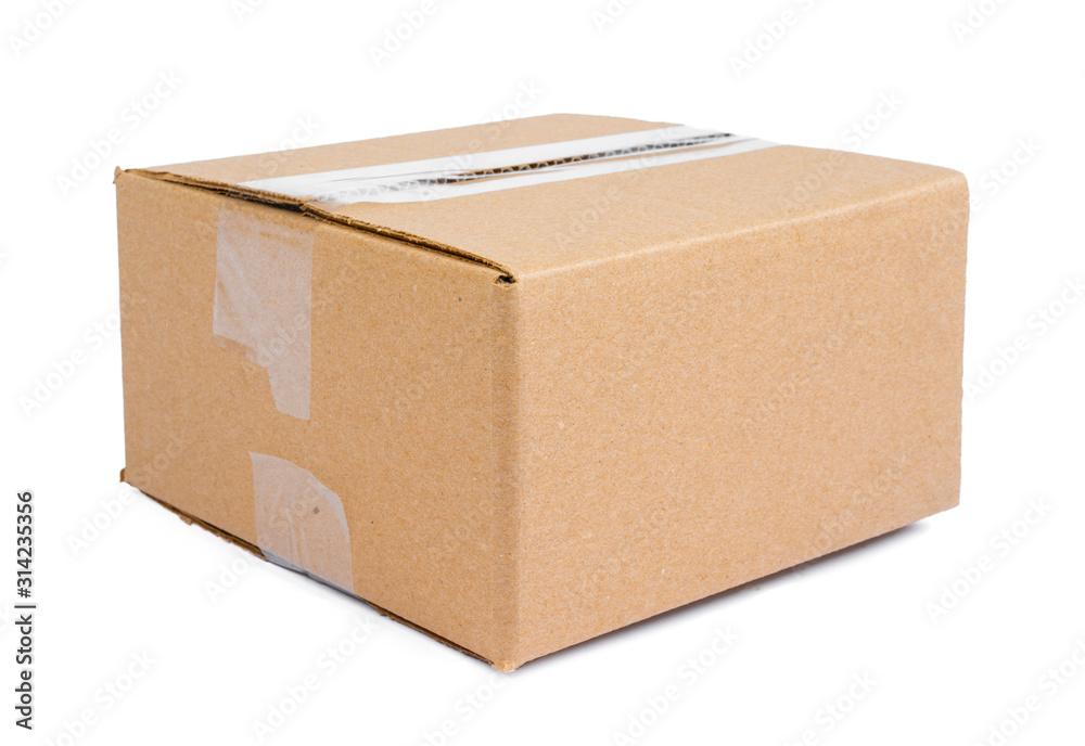 Fototapeta Single carton moving box isolated on white background