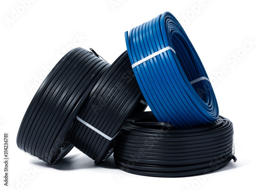 Fototapeta Coils of black and blue cable isolated on white background obraz