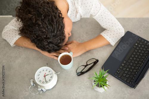 sleepy woman working from office Fototapeta