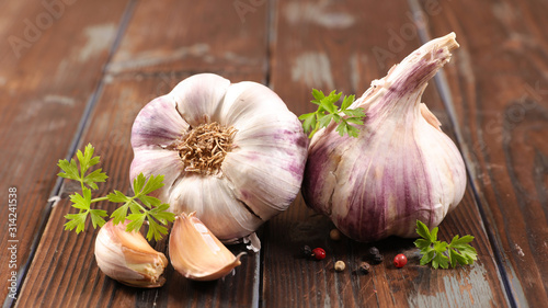 garlic clove and bulb on wood background Canvas Print