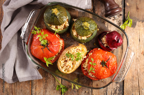 Obraz baked vegetable- tomato, zucchini and potato stuffed with cereal - fototapety do salonu