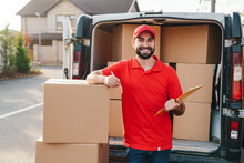 Image Of Delivery Man Holding ...