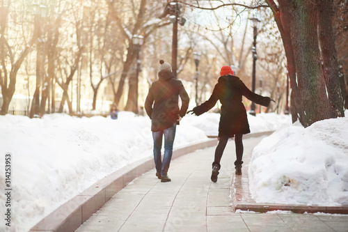 Young couple walking through the winter
