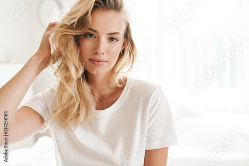 Smiling young beautiful blonde woman wearing t-shirt - 314256164