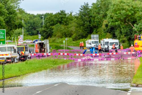 Fototapeta flood road in england blocked for emergency obraz