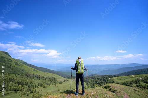 Obraz Active lifestyle. Traveling, hiking and trekking concept. Young woman with backpack in the Carpathian mountains. - fototapety do salonu