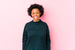 Middle aged african american woman against a pink background isolated happy, smiling and cheerful.