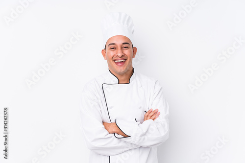 Young latin chef man isolated laughing and having fun. Wallpaper Mural