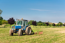Blue Vintage Tractor In The Field