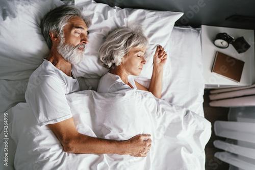 Fotografie, Obraz Senior family couple sleeping together in bed.