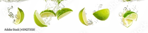 Fresh lime dropped into water with splash isolated on white - 314273138