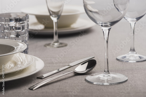 Selective focus of serving dishware on grey tablecloth