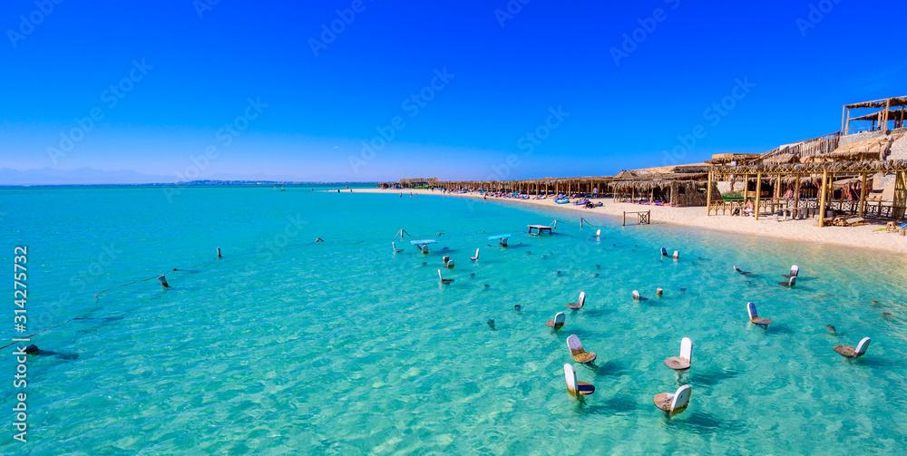 Fototapeta Orange Bay Beach with crystal clear azure water and white beach - paradise coastline of Giftun island, Mahmya, Hurghada, Red Sea, Egypt.