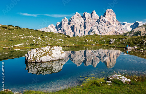 Wall mural - Beautiful mountain Scenery in Dolomites mountains by Tre Cime di Lavaredo national park. Fantastic lake with mountains peaks  reflected. Wondeful Nature Landscape. Picture of wild area of Italy.