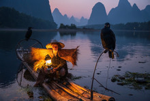An Old Fisherman Hold A Lamp O...