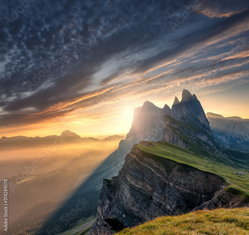 Majestic Odle group peaks on Dolomite Alps During Sunset. Unsurpassed Landscape of Dolomites Mountains with colorful Sky, under Sunlit. popular travel and hiking destination. Colorful summer sunrise.