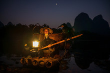 An Old Fisherman With A Lamp O...