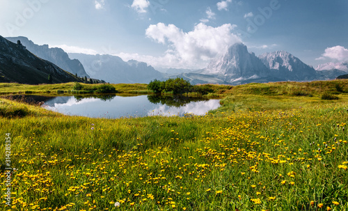 Wall mural - Wonderful landscape in Val Gardena with lake on a sunny day. Scenic image of famous Sassolungo peak. Amazing nature landscape in Dolomites Alps.  Dolomiti, Trentino Alto Adige, Bolzano, Italy, Europe
