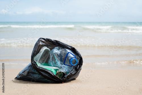 Fototapeta garbage bag on the beach. obraz