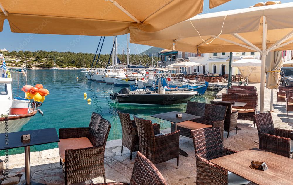 Wonderful Sunny seascape. Fiskardo village and harbor on Kefalonia Ionian island, Greece. popular travel destination. Amazing plase for holyday.