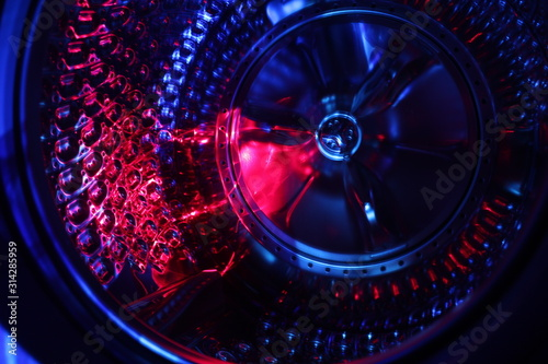 Photo  Abstract background with lots of light spots, Blue and Red Light shone on Tyre