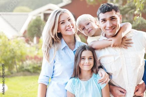 Fototapeta Beautiful smiling Lovely family on background obraz