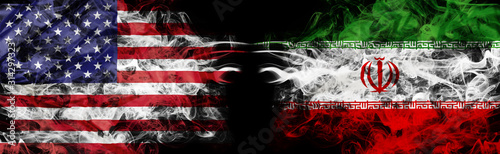 Obraz na plátně American flag and Iranian flag in smoke shape on black background