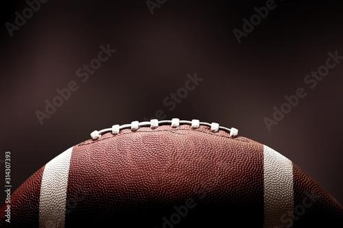Futbol amerykański piłka na ciemnym tle