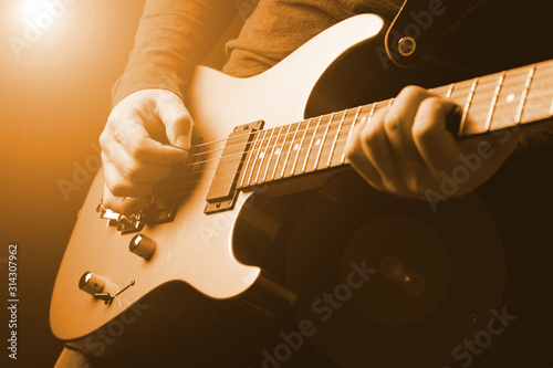 Fotografie, Obraz musician rock guitarist playing a guitar